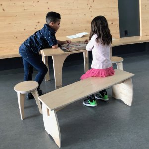 Natural Pod Children Playing at Table with Benches